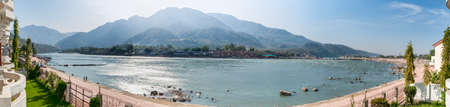 Panorama view of the Holy Ganges river that flows through Rishikesh (the world capital of Yoga) - the holy city for the Hindus, India. photo