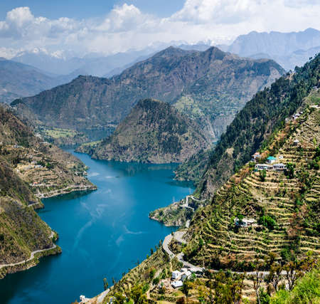 agriculture india: 46 kms long tehri lake filling up after the construction of the New Tehri hydro electric project Dam on the river ganga in tehri garhwal chamba Stock Photo