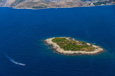 Aerial helicopter shoot of island Supetar in front of Cavtat town - Dubrovnik archipelago, Croatia. Stock Photo - 15308440