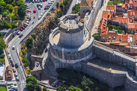Aerial helicopter shoot of Dubrovnik old town - fortress Minceta detail. photo