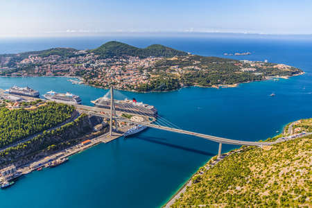 Aerial helicopter shoot of Dubrovnik bridge - entrance to the city and main harbor. photo