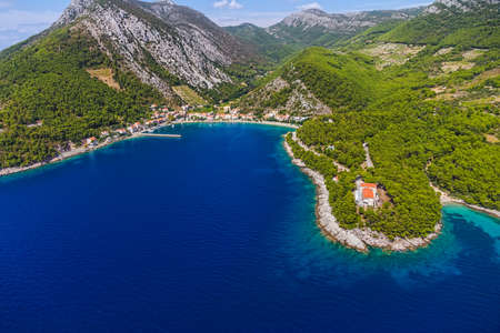 bight: Aerial helicopter photo of small fishing village Trstenik on Peljesac peninsula, Croatia