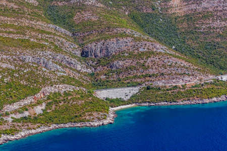 Croatian landscape near Dubrrovnik shot from helicopter with  small rocky beach. Stock Photo - 16587188