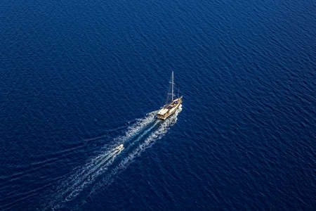 peacefully: Aerial helicopter shot with big luxury yacht. Stock Photo