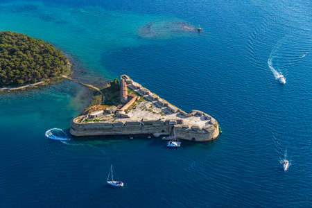 Aerial helicopter shoot of St. Nicholas Fortress - Sibenik archipelago, Croatia. Reklamní fotografie - 16680290