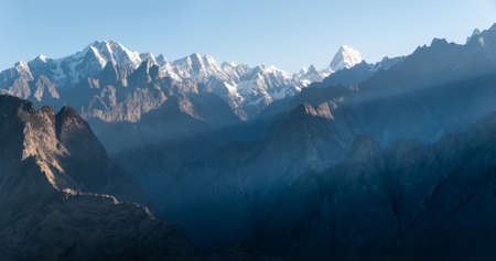 high sierra: Sunrise in the Himalayas, the first rays of the sun -  view from Auli, India. Stock Photo
