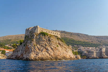 Dubrovnik old city defense walls details shot from a boat. Fortress st. Lawrence. Location Croatia - Europe.