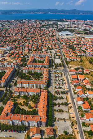 ZADAR, CROATIA - JULY 7:  Aerial view of city with residential area and new sport hall on July 7, 2012 in Zadar, Croatia.