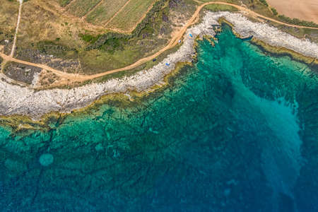 Aerial view of footpath trough macchia for tourist trekking with rocky beach in Istria, Croatia photo