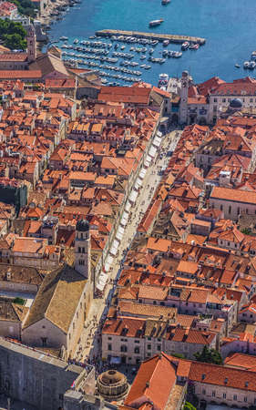 Aerial helicopter shoot of Dubrovnik old town. Main street Stradun (Placa) full visible. photo