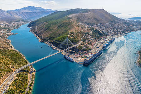 Aerial helicopter shoot of Dubrovnik bridge - entrance to the city