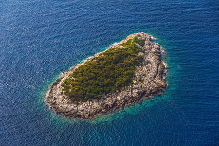 Helicopter aerial shoot of small island near Mljet - a tourist destination in Dubrovnik archipelago, Croatia photo