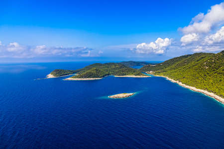 Aerial helicopter shoot of National park on island Mljet, Dubrovnik archipelago, Croatia. The oldest pine forest in Europe preserved. photo