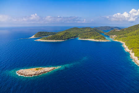 croatia: Aerial helicopter shoot of National park on island Mljet, Dubrovnik archipelago, Croatia. The oldest pine forest in Europe preserved.
