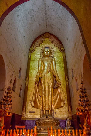 BAGAN, MYANMAR - FEB 22: Ancient golden Buddha statue  in Ananda Temple (Indian Style Structure) on Feb 22, 2012 in old Bagan, Myanmar. Built around 1105 by King Kyanzittha