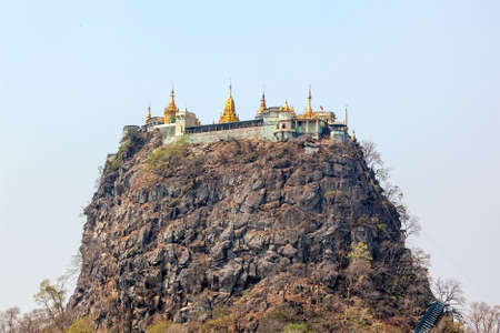Popa Taungkalat monastery atop an outcrop of Mount Popa volcano, Myanmar. photo