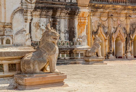 BAGAN, MYANMAR - FEBRUARY 23: Statues of the guardian Lion are positioned on every corner of ancient Ananda Temple on February 23, 2013 in Bagan, Myanmar. Built in 1105 AD during the reign of King Kyanzittha of the Pagan Dynasty.