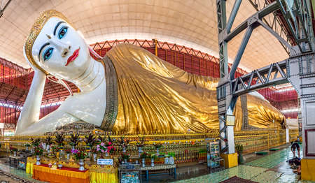 YANGON, MYANMAR - MARCH 1: The giant reclining Buddha fisheye shoot shows refinement of the work at Chaukhtatgyi temple on March 1, 2012 in Yangon, Myanmar. Biggest and most graceful Reclining Buddha statues in South East Asia.