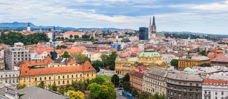 ZAGREB, CROATIA - JUNE 12: Panorama of the city center shoot from top of the skyscraper with a view to the intersection in front of national theater with cathedral in the distance on June 12, 2013 in Zagreb, Croatia.