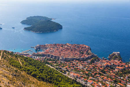 Aerial helicopter shoot of Dubrovnik old town and island Lokrum. photo