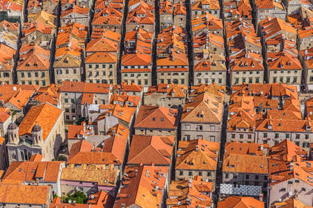 Aerial helicopter shoot of Dubrovnik old town roofs. photo