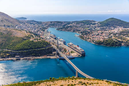 Aerial helicopter shoot of Dubrovnik bridge - entrance to the city and main harbor  photo