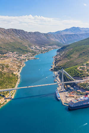 Aerial helicopter shoot of Dubrovnik bridge - entrance to the city photo