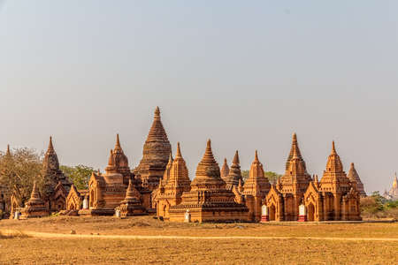 Panorama in Bagan  Group of temples and stupas with a field in a front photo