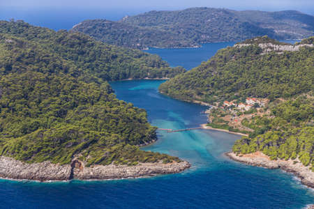 mediterranean forest: Aerial helicopter shoot of sea entrance of the National park on island Mljet, Dubrovnik archipelago, Croatia  The oldest pine forest in Europe preserved