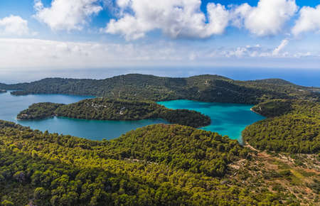 Aerial helicopter shoot of National park on island Mljet, Dubrovnik archipelago, Croatia  The oldest pine forest in Europe preserved  photo
