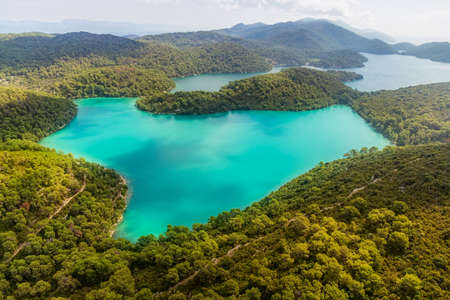 island paradise: Aerial helicopter shoot of National park on island Mljet, Dubrovnik archipelago, Croatia  The oldest pine forest in Europe preserved  Stock Photo
