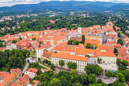 Old upper town in Zagreb with Church of St  Mark, funicular and Lotrscak tower  Emblem of Zagreb is on the roof of the church  Helicopter aerial view