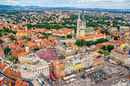 ZAGREB, CROATIA - MAY 26: City center view from helicoper with cathedral, central square Ban Jelacic and famous market on working day on May 26, 2012 Zagreb, Croatia.