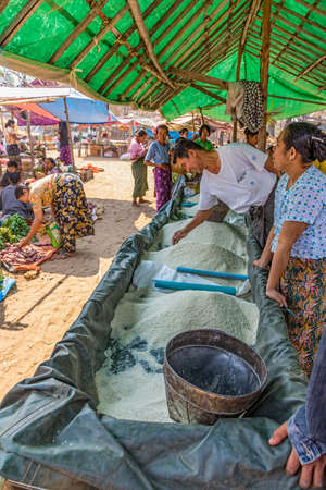 BAGAN, MYANMAR - FEB 24: Selling different kinds of rice at the local market on Feb 24, 2013 in Bagan, Myanmar.