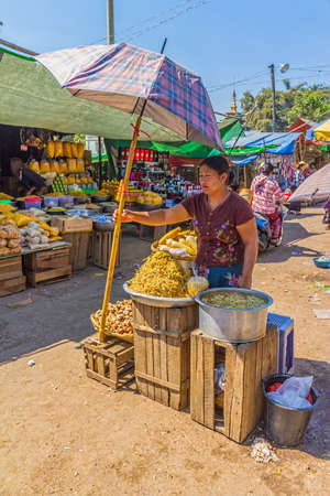 PINDAYA, MYANMAR - FEBRUARY 27:  Women are selling vegetables at the local market on February 27, 2013 in Pindaya, Myanmar.