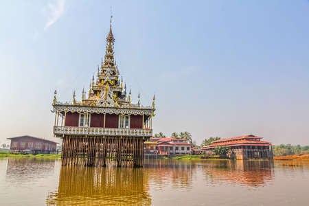 Wooden pagoda in he center of the floating village in Inle lake, Myanmar. photo