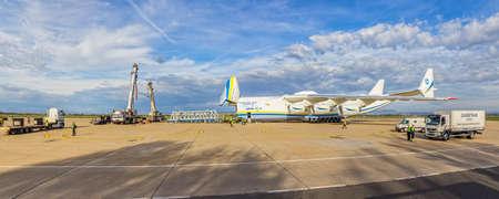 zagreb: ZAGREB, CROATIA - NOVEMBER 10: Loading heavy weight cargo to the Antonov 225 Mriya airplane on November 10, 2013 Zagreb, Croatia. It is the biggest airplane in the world.