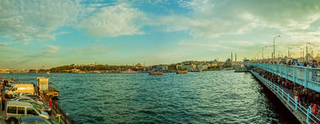 cami: ISTANBUL, TURKEY - SEPTEMBER 28: Looking towards the New Mosque (Yeni Cami) from the Galata Bridge with lot of fishermans fishing with rods on September 28th, 2013 Istanbul, Turkey.