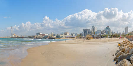 TEL AVIV, ISRAEL - MARCH 1, 2014: Skyline view of the old harbor transformed to the riviera with beaches and long promenade.