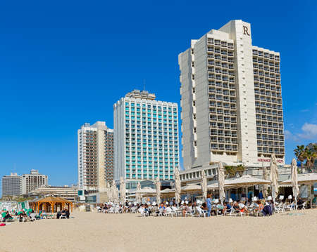 TEL AVIV, ISRAEL - MARCH 1, 2014: Panorama of the beach, riviera, hotels and long promenade along skyline shot from the beach. Stock Photo - 26829361