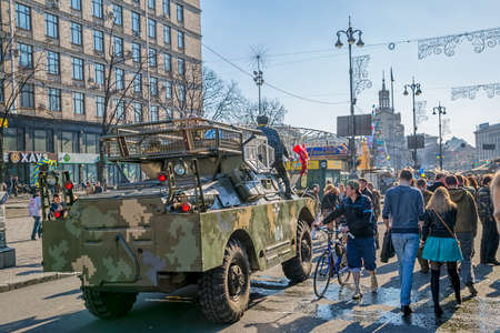 barricades: KIEV, UKRAINE - MARCH 22, 2014  People visiting Maidan square and barricades on the Khreshchatyk street, witch still stand because people distrust politicians and waiting for the Presidential elections  Editorial