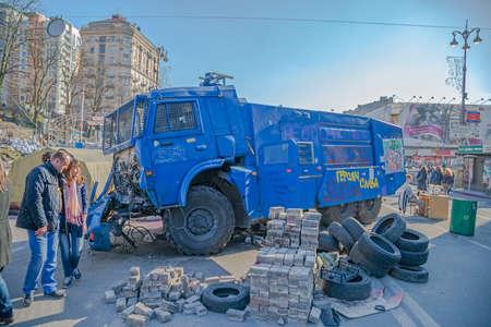 destructed: KIEV, UKRAINE - MARCH 22, 2014  People visiting destroyed police track at Khreshchatyk street near barricades