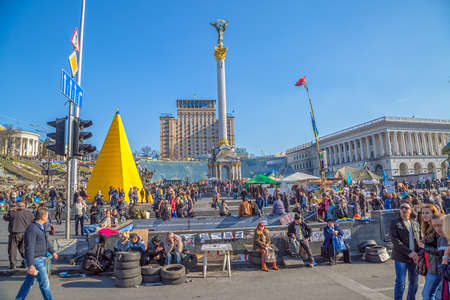 barricades: KIEV, UKRAINE - MARCH 22, 2014: People visiting Maidan square and barricades on the Khreshchatyk street, witch still stand because people distrust politicians and waiting for the Presidential elections.