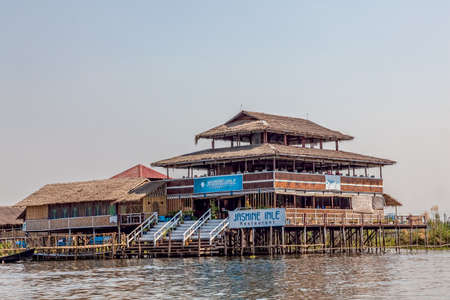 INLE LAKE, MYANMAR - FEBRUARY 28, 2013: Panorama of the small Floating village restaurant.