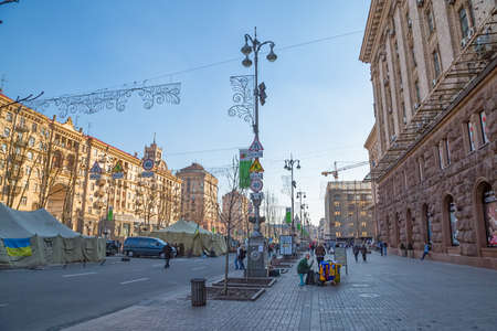 barricades: KIEV, UKRAINE - MARCH 22, 2014: People visiting Maidan square and barricades on the Khreshchatyk street, witch still stand because people waiting for the Presidential elections.