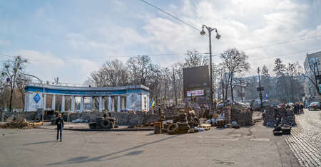 barricades: KIEV, UKRAINE - MARCH 22, 2014: People visiting barricades in front of entrance to the Dinamo Kiev Stadium witch still stands after Revolution in the center of the city.