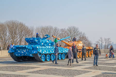 KIEV, UKRAINE - MARCH 22, 2014: Kids playing on the famous tanks in Kiev near Mother Motherland statue after having been repainted. Editorial