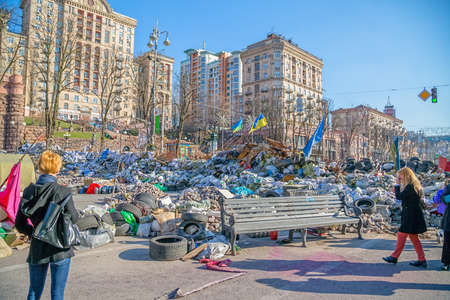 barricades: KIEV, UKRAINE - MARCH 22, 2014: Barricades on the Khreshchatyk street still stand waiting for the Presidential elections. People visiting Maidan every day.