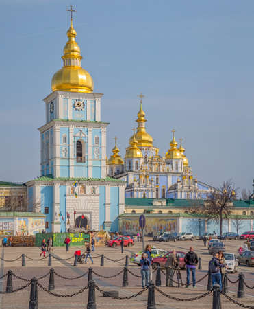KIEV, UKRAINE - MARCH 23, 2014: St. Michaels Golden-Domed Monastery with barricades still stands in front of it, with TV crew filming it..
