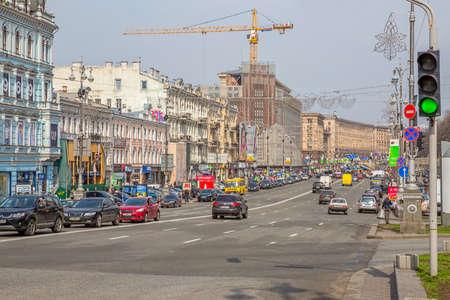 trafic: KIEV, UKRAINE - MARCH 24, 2014: Mid-day in the center of Kiev in the Khreshchatyk street.